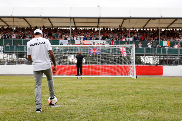 Silverstone, Northamptonshire, England. Thursday 3 July 2014. Lewis Hamilton, Mercedes AMG, takes some penalty kicks as part of a feature for Sky Sports F1. World Copyright: Andrew Ferraro/LAT Photographic. ref: Digital Image _FER9724
