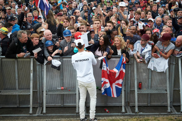 Silverstone, Northamptonshire, UK.  Saturday 15 July 2017. Lewis Hamilton, Mercedes AMG, signs autographs for fans. World Copyright: Steve Etherington/LAT Images  ref: Digital Image SNE12443
