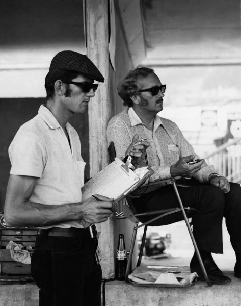 Colin Chapman, founder and team owner, Lotus F1 Racing, with Peter Warr, portrait.World Copyright: LAT Photographic.Ref: B/WPRINT.