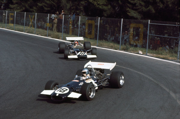 Mexico City, Mexico. 19 October 1969.Piers Courage (Brabham BT26-Ford), 10th position, leads Jo Siffert (Lotus 49B-Ford), retired, action. World Copyright: LAT PhotographicRef: Colour Transparency.