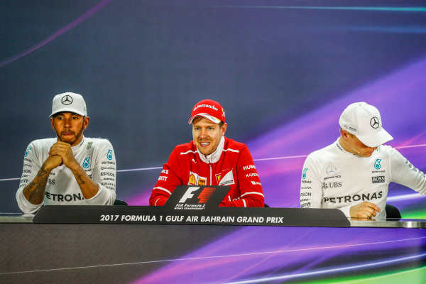 Bahrain International Circuit, Sakhir, Bahrain.  Sunday 16 April 2017. Lewis Hamilton, Mercedes AMG, 2nd Position, Sebastian Vettel, Ferrari, 1st Position, and Valtteri Bottas, Mercedes AMG, 3rd Position, in the Press Conference. World Copyright: Sam Bloxham/LAT Images ref: Digital Image _W6I3351