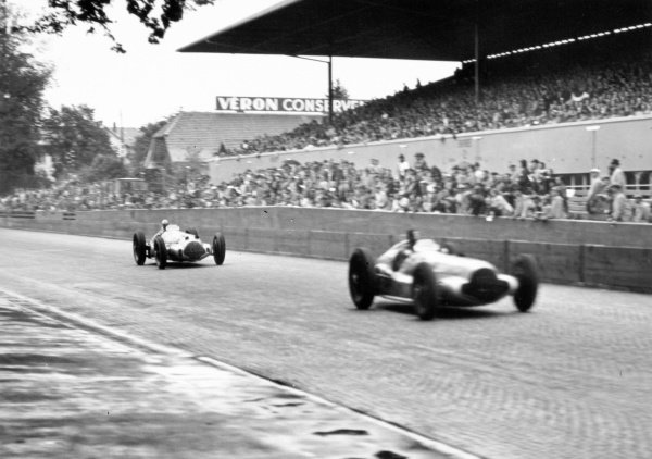 1938 Swiss Grand Prix.  Bremgarten, Berne, Switzerland. 21 August 1938.  Dick Seaman, Mercedes-Benz W154, 2nd position, leads Rudolf Caracciola, Mercedes-Benz W154, 1st position, in their duel for the lead.  Ref: RF38_SWI_62. World Copyright: Robert Fellowes/LAT Photographic