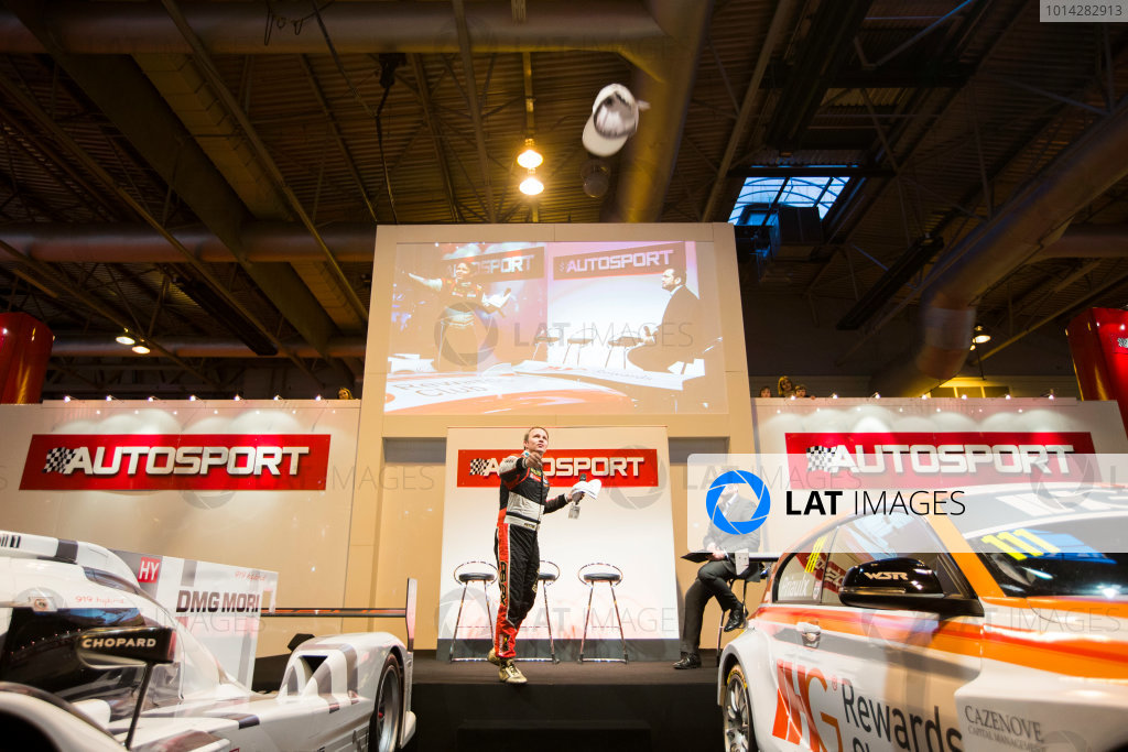 Autosport International Exhibition. National Exhibition Centre, Birmingham, UK. Sunday 11 January 2015. Petter Solberg throws caps into the crowd after his interview on the Autosport stage. World Copyright: Zak Mauger/LAT Photographic. ref: Digital Image _L0U5091