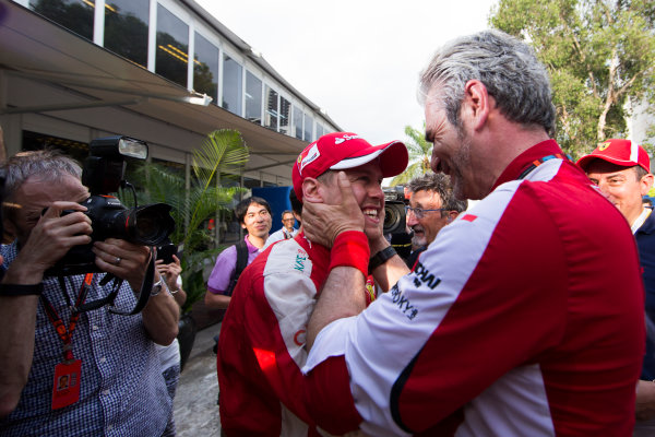 Sepang International Circuit, Sepang, Kuala Lumpur, Malaysia. Sunday 29 March 2015. Sebastian Vettel, Ferrari, celebrates his win with Mauricio Arrivabene, Team Principal, Ferrari. World Copyright: Lorenzo Bellanca/LAT Photographic. ref: Digital Image _00P1916