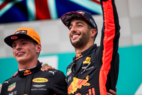 Sepang International Circuit, Sepang, Malaysia. Sunday 1 October 2017. Max Verstappen, Red Bull, 1st Position, and Daniel Ricciardo, Red Bull Racing, 3rd Position, on the podium. World Copyright: Zak Mauger/LAT Images  ref: Digital Image _56I3661