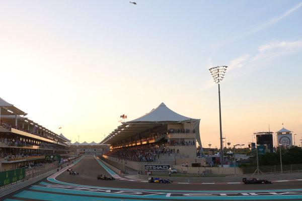 Yas Marina Circuit, Abu Dhabi, United Arab Emirates. Sunday 29 November 2015. Jenson Button, McLaren MP4-30 Honda, leads Felipe Nasr, Sauber C34 Ferrari, and Romain Grosjean, Lotus E23 Mercedes. World Copyright: Will Taylor-Medhurst/LAT Photographic ref: Digital Image 267A9996