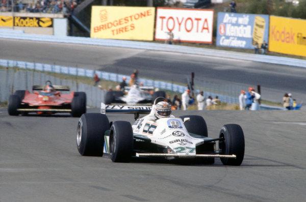 Watkins Glen, USA. 3-5 October 1980. Alan Jones (Williams FW07B-Ford Cosworth) leads Gilles Villeneuve (Ferrari 312T5) and Carlos Reutemann  (Williams FW07B-Ford Cosworth). World Copyright: LAT Photographic. Ref: 80USA03