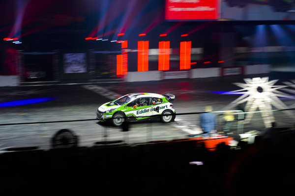 Mark Higgins performs in a Ford rally car in the Live Action Arena.