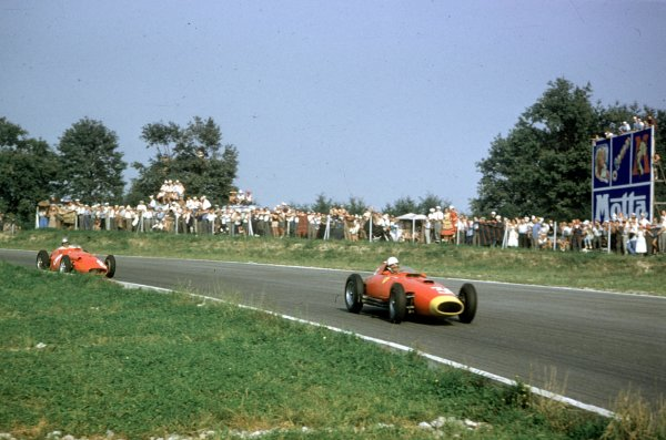 1957 Italian Grand Prix.Monza, Italy.6-8 September 1957.Wolfgang von Trips (Lancia-Ferrari D50 801) leads Giorgio Scarlatti (Maserati 250F). They finished in 3rd and 5th positions respectively.Ref-57 ITA 17.World Copyright - LAT Photographic