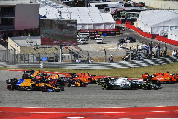 Sebastian Vettel, Ferrari SF90, leads Lewis Hamilton, Mercedes AMG F1 W10, Charles Leclerc, Ferrari SF90, Alexander Albon, Red Bull RB15, Carlos Sainz Jr., McLaren MCL34, and Lando Norris, McLaren MCL34, at the start