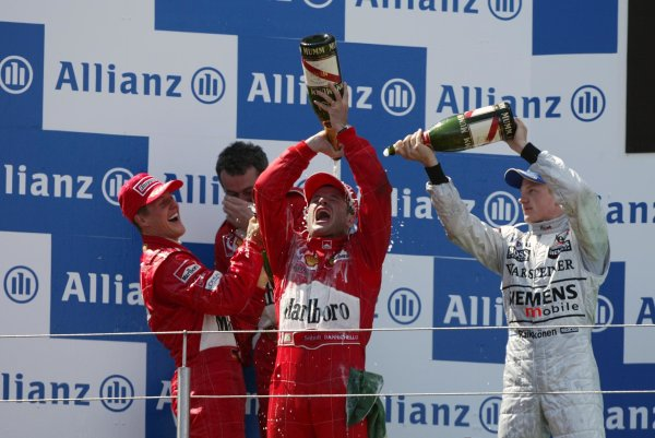 2002 European Grand Prix - RaceNurburgring, Germany. 23rd June 2002Race winner Rubens Barrichello, Ferrari F2002, celebrates with 2nd place Michael Schumacher, podium.World Copyright: Steve Etherington/LATref: Digital Image Only