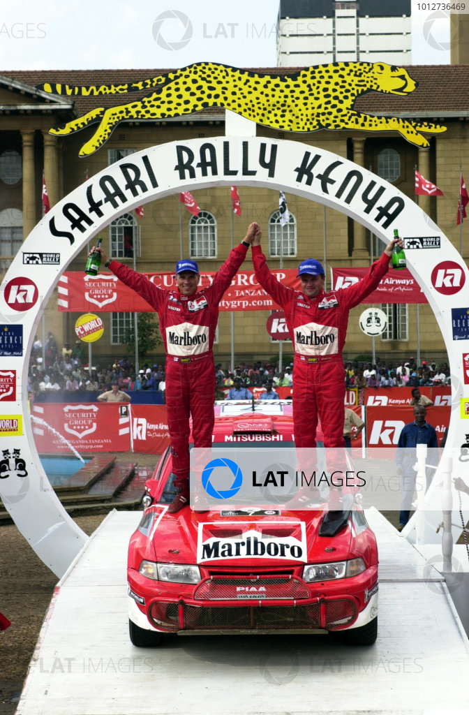 2001 World Rally Championship.Nairobi, Kenya. July 20-22, 2001Tommi Makinen and Risto Mannisenmaki celebrate their victory on the podium.Photo: Ralph Hardwick/LAT