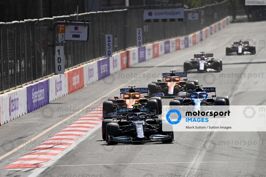 Valtteri Bottas, Mercedes W12, leads Esteban Ocon, Alpine A521, Lando Norris, McLaren MCL35M, and Daniel Ricciardo, McLaren MCL35M