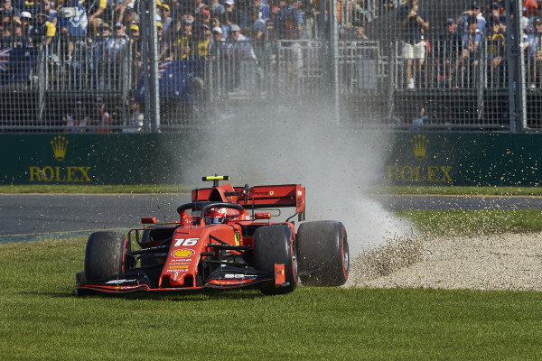Charles Leclerc, Ferrari SF90, cuts across the grass