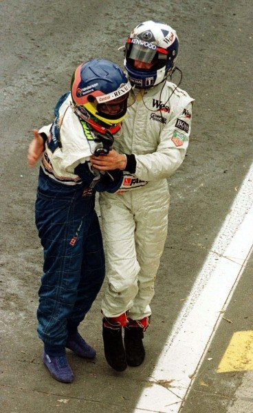 1997 Brazilian Grand Prix.Interlagos, Sao Paulo, Brazil.28-30 March 1997.Jacques Villeneuve (Williams Renault) is congratulated by David Coulthard (McLaren Mercedes-Benz) after he finished in 1st position.World Copyright - LAT Photographic