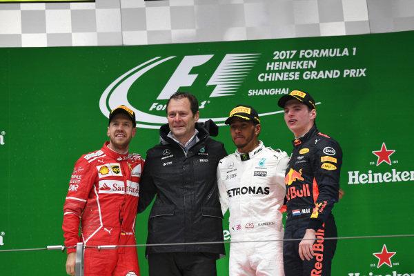 Sebastian Vettel (GER) Ferrari, Aldo Costa (ITA) Mercedes AMG F1 Engineering Director, Lewis Hamilton (GBR) Mercedes AMG F1 and Max Verstappen (NED) Red Bull Racing celebrate on the podium at Formula One World Championship, Rd2, Chinese Grand Prix, Race, Shanghai, China, Sunday 9 April 2017.