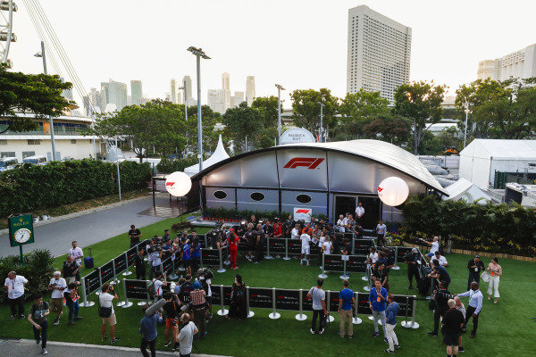The media gather outside the F1 TV production unit for the daily drivers media session.