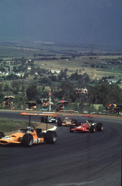 1969 South African Grand Prix.Kyalami, South Africa.27/2-1/3 1969.Bruce McLaren (McLaren M7A Ford) leads Chris Amon (Ferrari 312), John Love and Jo Siffert (both Lotus 49B Ford's).Ref-69 SA 12.World Copyright - LAT Photographic