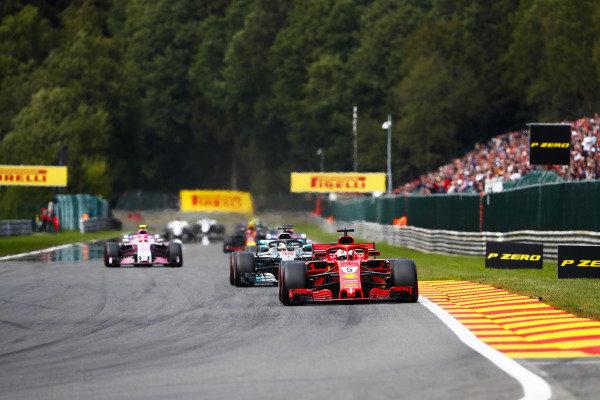 Sebastian Vettel, Ferrari SF71H, leads Lewis Hamilton, Mercedes AMG F1 W09, Sergio Perez, Racing Point Force India VJM11, and Esteban Ocon, Racing Point Force India VJM11