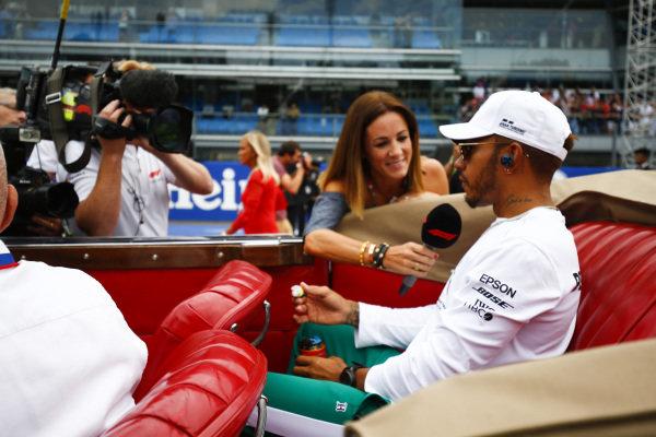 Lewis Hamilton, Mercedes AMG F1, talks to Natalie Pinkham, TV Presenter, on the drivers parade.