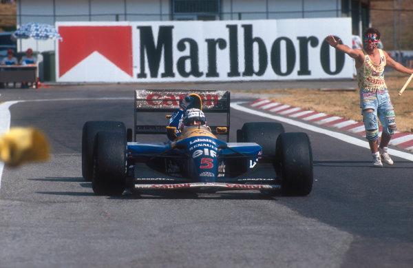 1992 Hungarian Grand Prix.Hungaroring, Budapest, Hungary.14-16 August 1992.Nigel Mansell (Williams FW14B Renault) 2nd position, celebrates winning the drivers World Championship.Ref-92 HUN 07.World Copyright - LAT Photographic