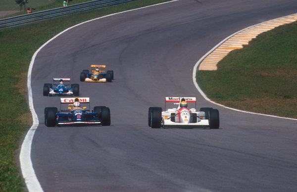 1992 Brazilian Grand Prix.Interlagos, Sao Paulo, Brazil.3-5 April 1992.Ayrton Senna (McLaren MP4/7A Honda) alongside Nigel Mansell (Williams FW14B Renault) during qualifying.Ref-92 BRA 10.World Copyright - LAT Photographic