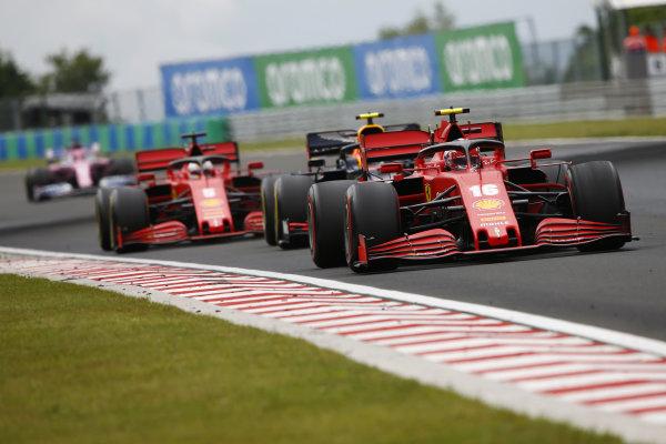 Charles Leclerc, Ferrari SF1000, leads Alexander Albon, Red Bull Racing RB16 and Sebastian Vettel, Ferrari SF1000