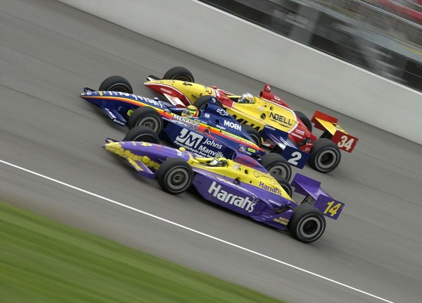 2002 IRL Michigan, 28 July, 2002#14 Airton Dare(Bottom), #2 MArk Dismore (Middle), #34 Laurent Redon race three wide at the Michigan Indy 400Copyright: Todd Bauders/LAT Photographic