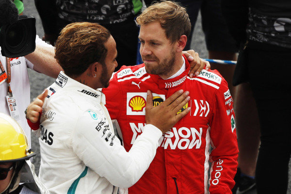 Sebastian Vettel, Ferrari, congratulates Lewis Hamilton, Mercedes AMG F1 in Parc Ferme