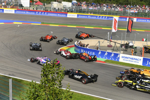 Charles Leclerc, Ferrari SF90, leads Sebastian Vettel, Ferrari SF90, Lewis Hamilton, Mercedes AMG F1 W10 and Valtteri Bottas, Mercedes AMG W10. Behind, Max Verstappen, Red Bull Racing RB15 makes contact with Kimi Raikkonen, Alfa Romeo Racing C38
