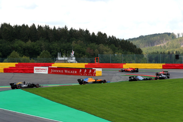 Charles Leclerc, Ferrari SF90, leads Sebastian Vettel, Ferrari SF90, Lewis Hamilton, Mercedes AMG F1 W10, Valtteri Bottas, Mercedes AMG W10, Lando Norris, McLaren MCL34, Romain Grosjean, Haas VF-19, and the rest of the field