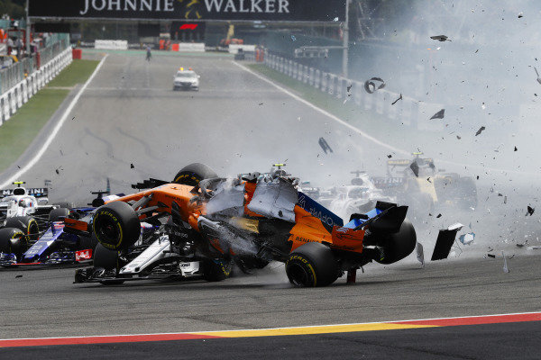Fernando Alonso, McLaren MCL33, crashes over Charles Leclerc, Alfa Romeo Sauber C37, after contact from Nico Hulkenberg, Renault Sport F1 Team R.S. 18, at the start.