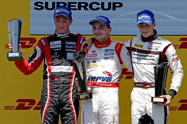 Podium and results: 1st Kuba Giermaziak (POL) Verva Racing Team, centre. 2nd Jeffrey Schmidt (SUI) Lechner Racing Team, left. 3rd Sven Muller (GER) Team Project 1, right. Porsche Supercup, Rd3, Spielberg, Austria, Sunday 21-22 June 2014.