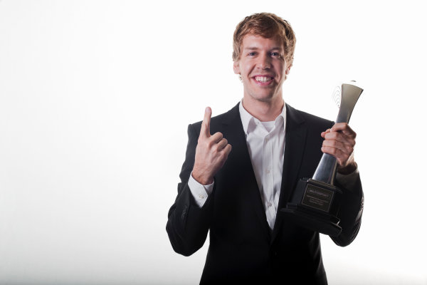 Grosvenor House Hotel, Park Lane, London 4th December 2011 Sebastian Vettel with his International Racing Driver of the Year trophy. Portrait.World Copyright: Malcolm Griffiths/LAT Photographic ref: Digtal Image MG5D7449