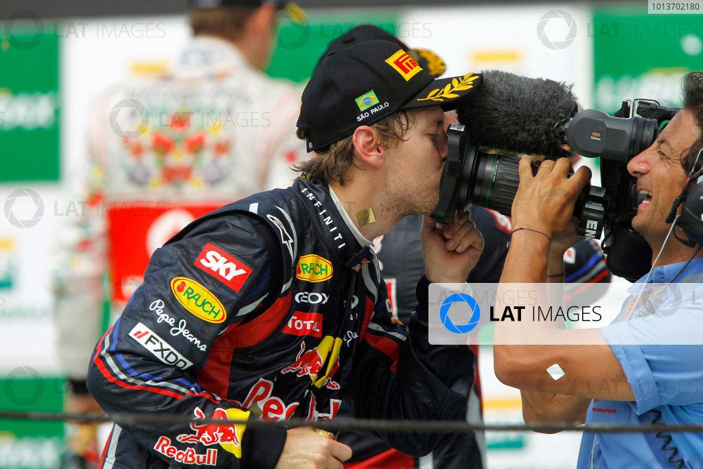 Interlagos, Sao Paulo, Brazil.27th November 2011.Sebastian Vettel, Red Bull Racing RB7 Renault gives the camera a kiss after the race.World Copyright:Andrew Ferraro/LAT Photographicref: Digital Image _Q0C6532