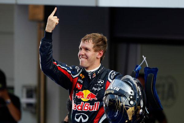 Korea International Circuit, Yeongam-Gun,South Korea. 16th October 2011. Sebastian Vettel, Red Bull Racing RB7 Renault, 1st position, celebrates in Parc Ferme. Portrait. Helmets. Finish.  World Copyright: Andrew Ferraro/LAT Photographic ref: Digital Image _Q0C7998