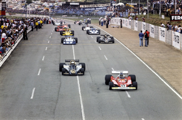 Carlos Reutemann, Ferrari 312T2 leads Jody Scheckter, Wolf WR1 Ford on the formation lap.