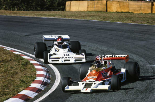 James Hunt, McLaren M26 Ford leads Hans Binder, Surtees TS19 Ford.