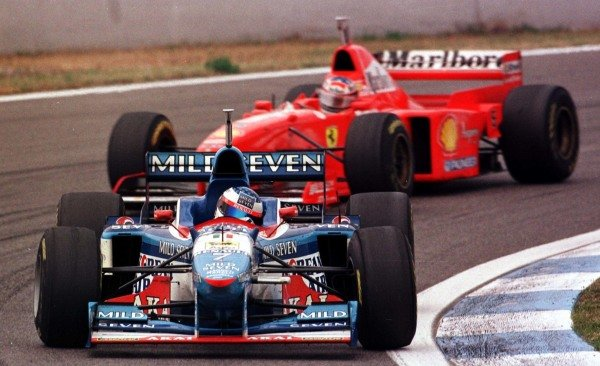 1997 Spanish Grand Prix.Catalunya, Barcelona, Spain.23-25 May 1997.Jean Alesi (Benetton B197 Renault) leads Michael Schumacher (Ferrari F310B). They finished in 2nd and 4th positions respectively.World Copyright - Tee/LAT Photographic