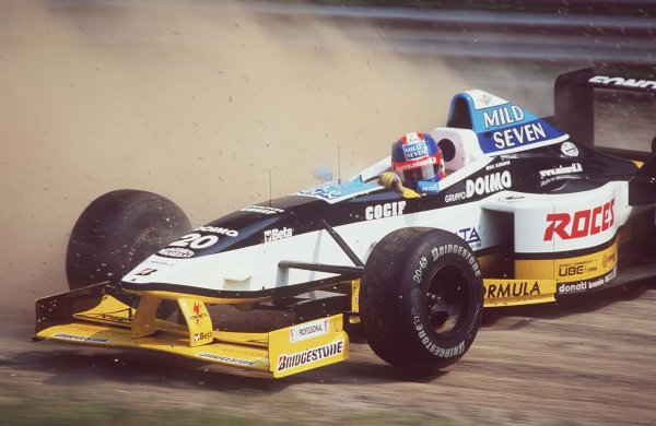 1997 Italian Grand Prix.Monza, Italy.5-7 September 1997.Uyko Katayama (Minardi M197 Hart) spins at the Parabolica during practice.World Copyright - LAT Photographic