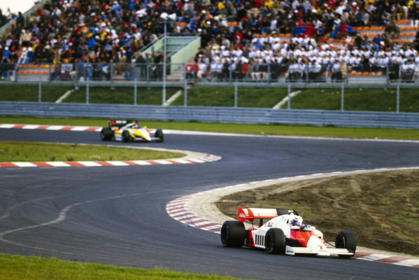 Alain Prost, McLaren MP4-2 TAG, leads Patrick Tambay, Renault RE50.