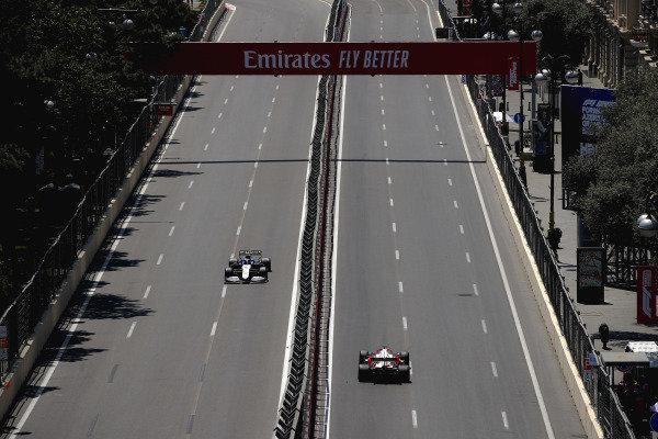 Kimi Raikkonen, Alfa Romeo Racing C41, leads Nicholas Latifi, Williams FW43B
