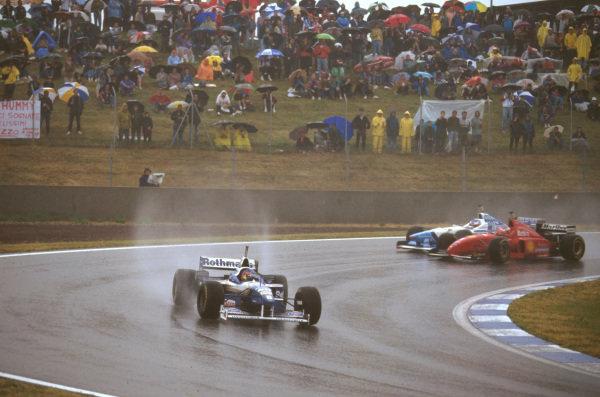 Catalunya, Barcelona, Spain.31/5-2/6 1996.Jacques Villeneuve (Williams FW18 Renault) leads Michael Schumacher (Ferrari F310) and Jean Alesi (Benetton B196 Renault) who battle behind earlier in the race.Ref-96 ESP 07.World Copyright - LAT Photographic