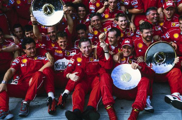 Michael Schumacher, 1st position, Rubens Barrichello, 2nd position, Jean Todt, Team Principal, Ferrari, and the Ferrari team celebrate victory.