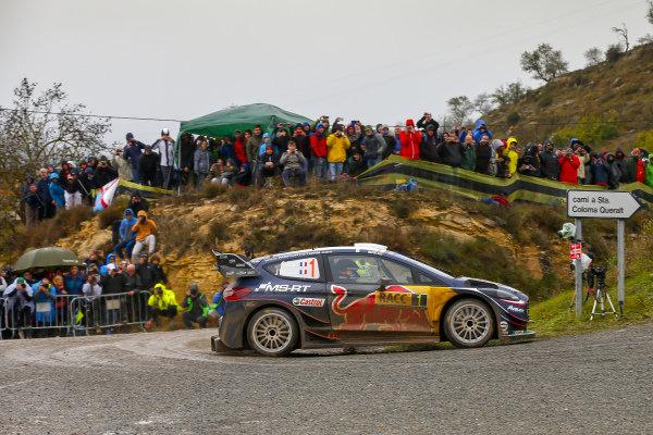 Sébastien Ogier, M-Sport Ford, Ford Fiesta WRC 2018, throw his car into a tight gravel strewn corner on Rally Catalunya, Spain.