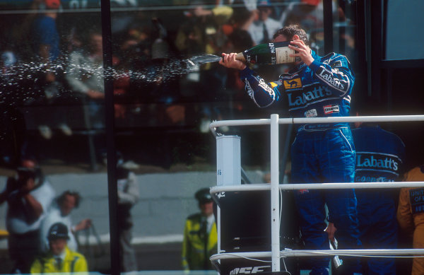 1992 British Grand Prix.Silverstone, England.10-12 July 1992.Nigel Mansell (Williams FW14B Renault) sprays the champagne celebrating 1st position on the podium.Ref-92 GB 12.World Copyright - LAT Photographic