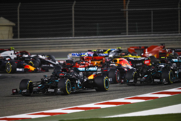 George Russell, Mercedes F1 W11 EQ Performance, leads Sergio Perez, Racing Point RP20, Max Verstappen, Red Bull Racing RB16, Valtteri Bottas, Mercedes F1 W11 EQ Performance, Charles Leclerc, Ferrari SF1000, and the rest of the field at the start