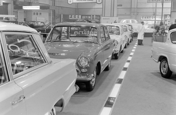 Ford Cortina Mk1's (left) and a Ford Anglia (right).