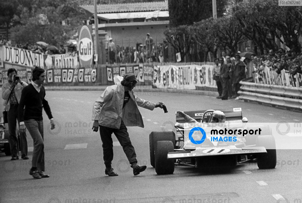 Race winner Jackie Stewart (GBR) Tyrrell 003 receives a bottle of Coke Cola from Richard Hill (GBR) Tyrrell Team Mechanic at the end of the race.  Monaco Grand Prix, Rd 3, Monte Carlo, Monaco, 23 May 1971.