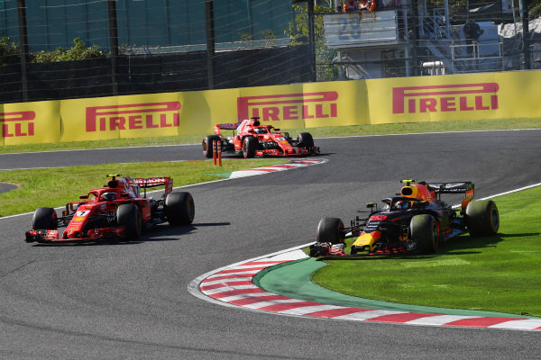 Kimi Raikkonen, Ferrari SF71H amd Max Verstappen, Red Bull Racing RB14 battle